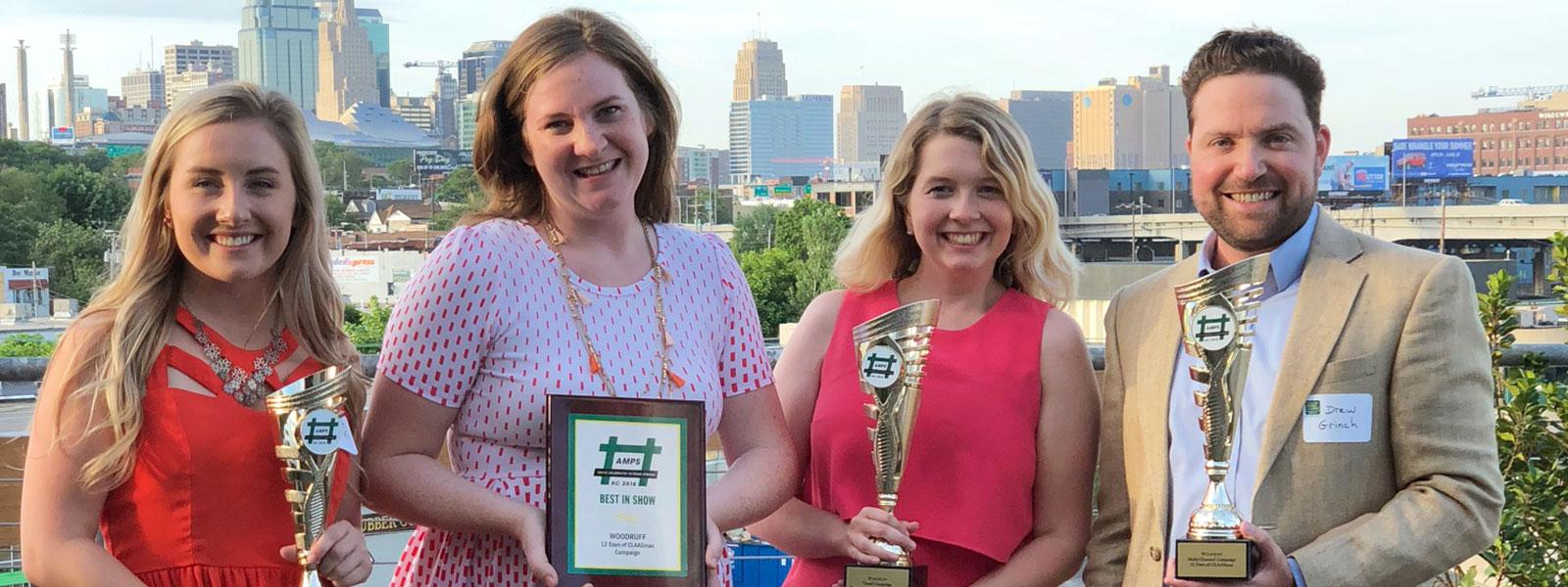 Woodruff's Kansas City social media team holding awards